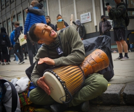 A musician playing on the street at a 'Black Lives Matter' protest in London. Photograph taken by Daniella Ekundayo